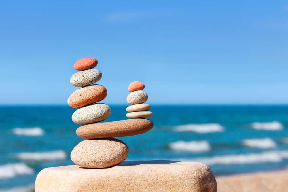 Stones balancing against ocean view