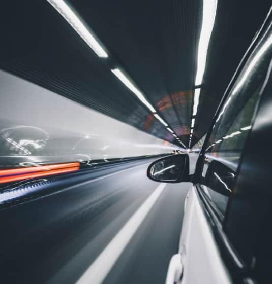 A car driving down a tunnel